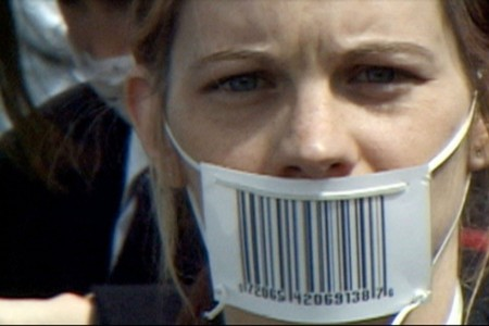 TheCorporation--woman-barcode-gagged.jpg